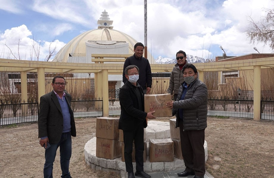 CEC Wangyal hands over sanitizers to CMO, Leh, and CRO,Tibetan Settlement